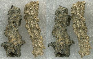 Fulgurite - Two small Type I Saharan Desert fulgurites. In a planar view the specimen on the right has a blade-like morphology, but its tubular nature is dramatically shown in a stereo view.