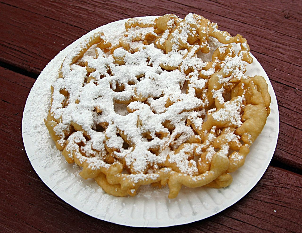 Funnel Cake With Strawberry Topping And Whipped Cream