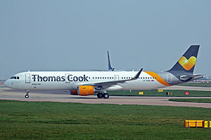 Thomas Cook Airlines - Thomas Cook Airlines Airbus A321-200 taxiing at Manchester Airport, UK.
