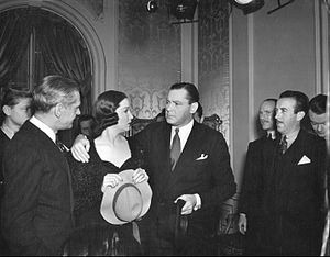 Mad About Music - Surrounded by reporters, Gwen Taylor (Gail Patrick) and Richard Todd (Herbert Marshall) answer a barrage of questions following the press conference in Mad About Music