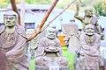 Garden with stone buddhas in Arashiyama.jpg
