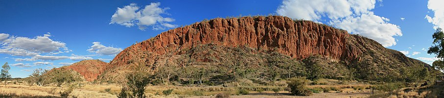 Late afternoon sun on the western wall of the Glen Helen Gorge in the West MacDonnell Ranges, Northern Territory, Australia.