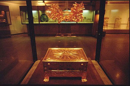 The Vergina Sun, the 16-ray star covering the royal burial larnax of Philip II of Macedon (r. 359-336 BC), discovered in the tomb of Vergina, formerly ancient Aigai Phillip Museum.jpg