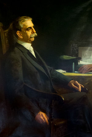 Herbert W. Ladd - Official portrait in the RI State House. Note the bicycle seat visible to Ladd's left.