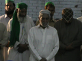 Hazrat Pir Syed Shah Mubasshir during salam after mehfil.png