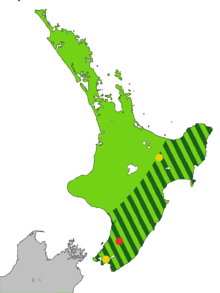 Map of the North Island of New Zealand coloured light green with dark green stripes from the central mountains to the sea along the east coast to Wellington, and one red and two yellow dots.