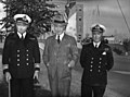 Hon. Angus L. Macdonald, Minister of National Defence for Naval Services, with senior R.C.N. officers.jpg