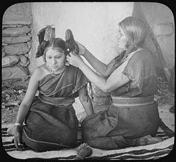 Hopi woman dressing hair of unmarried girl, 1900 - NARA - 520082.jpg