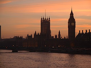 A photo of the UK's Palace of Westminster seen from across the River Thames at dusk