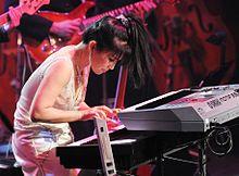 https://upload.wikimedia.org/wikipedia/commons/thumb/d/d9/Jazz_pianist_Keiko_Matsui.JPG/220px-Jazz_pianist_Keiko_Matsui.JPG