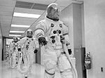 Jim Lovell leads Fred Haise and Jack Swigert to the transfer van.jpg