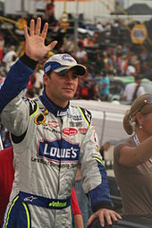 NASCAR driver Jimmie Johnson waves to fans