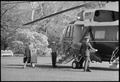 Jimmy Carter carries his bags as he boards Marine One - NARA - 174071.tif
