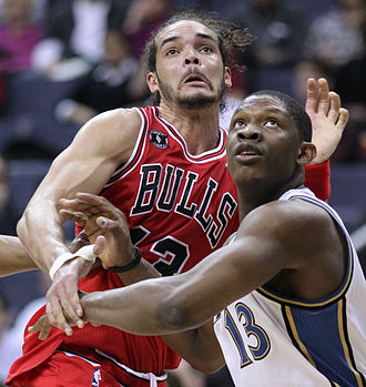 Joakim Noah - Noah with the Bulls in February 2011, contesting with Kevin Séraphin of the Washington Wizards