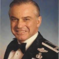 John Dramesi's USAF portrait taken in the early 1980s.png