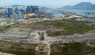 Lung Tsun Stone Bridge - Site of the former Kai Tak Airport, under redevelopment in 2010. The archaeological excavations of the Lung Tsun Stone Bridge are visible in the foreground.