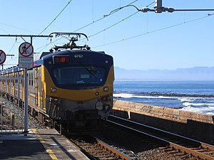 Rail transport in South Africa - A Metrorail train pulling out of Kalk Bay station in Cape Town