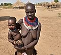 Karo woman with baby (5) (29163245096).jpg