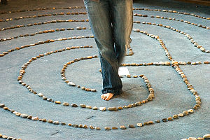English: A woman walking a prayer labyrinth