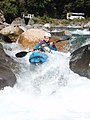 Kayaker on Hollyford river NZ.JPG