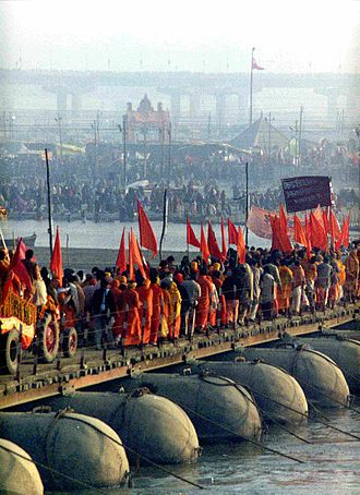 Mela - A procession of Akharas marching over a temporary bridge over the Ganges river, Kumbh Mela at Allahabad, 2001