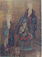 A deity seated on a pedestal surrounded by five robed standing figures.