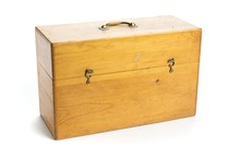 An upright rectangular wooden box with a hinged lid, clasp fastenings and a handle