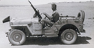 Operation Caravan - Captain Timpson of G1 Patrol in his jeep. Mounted on the mudguard was a green flag, indicating a patrol leader.
