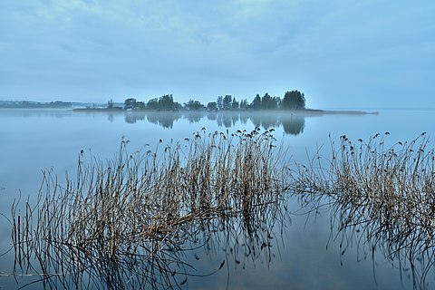A foggy and humid morning over a famous lake. The fog is very dense blue shade