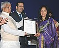 Lalu Prasad presenting the Dr. Ram Tarneja Award for best article in Indian Management to Prof. Seema Girdhar, Sr. Lecturer, Guru Nanak Institute of Management.jpg