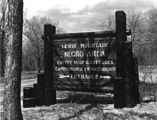 "Park sign reading: ""Lewis Mountain - Negro Area - Coffee Shop & Cottages - Campground Picnicground - Entrance"""