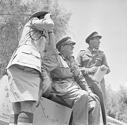 Lieutenant General Sir George Erskine, Commander-in-Chief, East Africa (centre), observing operations against the Mau Mau.jpg
