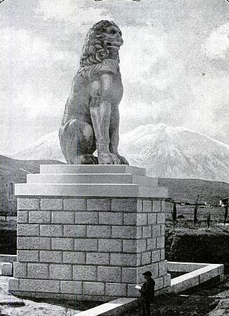 Sacred Band of Thebes - The Lion of Chaeronea as it appeared circa 1914 (note person in foreground for scale). It was erected by the Thebans in memory of their dead after the battle of Chaeronea.