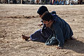 Local boys wrestle, outside of the Zhari District Center, Kandahar province, Afghanistan, Dec. 24, 2011 111224-A-VB845-056.jpg