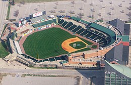 An aerial view of a green baseball field and the surrounding grandstand