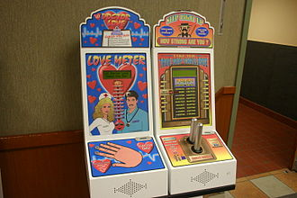 Love tester machine - A Love Meter (left) beside a strength tester machine at a Framingham, Massachusetts rest stop