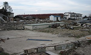 Lower Ninth Ward - Ruins of residential area in the Lower 9th Ward, with ING 4727 barge in the background