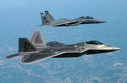 The first operational F-22A Raptor alongside an F-15D Eagle on its delivery flight to Langley AFB in May 2005.