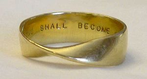 A Möbius strip employed as a gold wedding band...