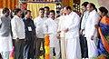 "M. Venkaiah Naidu lighting the lamp at the foundation stone laying ceremony for ""VIT -AP"", at Ainavolu, Thullur Mandal, in Amaravathi, Andhra Pradesh.jpg"