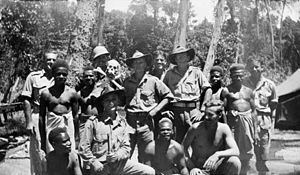 M Special Unit - Members of M Special Unit with New Guineans in August 1945.