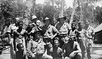 M Special Unit - Members of M Special Unit with New Guineans, 1945