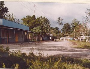 Buin, Papua New Guinea - Four Buin main-street trade stores on a Sunday morning, 1978