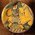 Maiolica di montelupo, piatto con figura, fusciacca e bandiera, 1620-40 ca..JPG