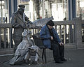 Man by a Statue.jpg