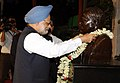 Manmohan Singh garlanding at the statue of Prof. Magnath Saha during his visit at the Closing Ceremony of 1st Diamond Jubilee Year of the Saha Institute of Nuclear Physics, in Kolkata on August 21, 2011.jpg