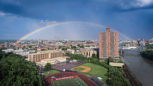Marble Hill, Manhattan - An overview of Marble Hill, seen from the west. The John F. Kennedy Educational Campus can be seen in the foreground, and the rest of the neighborhood is in the center. The Bronx is in the background.