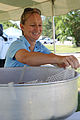 """Mary Mathews, Combat Logistics Battalion-6 Family Readiness officer, sets up a cotton-candy machine for the 2nd Marine Logistics Group """"Family Day"""" event on Camp Lejeune, N.C., May 11, 2012 120511-M-KS710-004.jpg"""