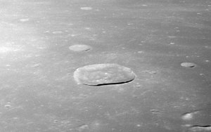 Maskelyne (crater) - Oblique view facing west from Apollo 11, showing Maskelyne at center, with Maskelyne B above center, Maskelyne G near top center, Maskelyne X and Y in upper left, and Maskelyne K at right.