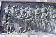 This bas-relief depicting the signing of the Mayflower Compact is on Bradford Street in Provincetown directly below the Pilgrim Monument.